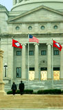 A Moment of Awe. A man and woman stand on the steps of the Arkansas capital and look up at the two flags; one is the Arkansas State Flag and the other is the Stock Images
