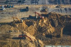 The moment of construction, digging of a ditch with excavators, foundation laying. royalty free stock image