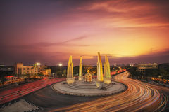 Moment of Democracy monument at Dusk. (Bangkok, Thailand) sunset and traffic royalty free stock photo