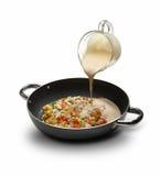 Moment för att laga mat på vit bakgrund Fotografering för Bildbyråer