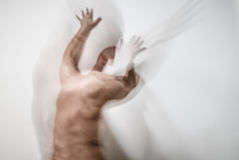Moment of fury. Blurred man suffering from dementia and insanity, scratching wall with hands, screaming, in moment of fury, victim of hallucination stock photography