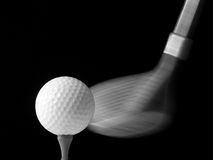 Moment of impact. A golf driver about to hit a golf ball - over black royalty free stock photo