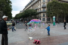 A moment of joy. The emotion given by a soap bubble Stock Image