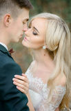 Moment before a kiss between stunning newlyweds royalty free stock photography