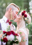 A moment before a kiss between young wedding couple Stock Images