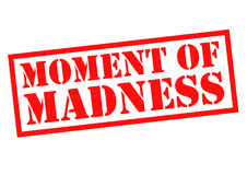 MOMENT OF MADNESS. Red Rubber Stamp over a white background Royalty Free Stock Photography