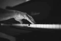 Moment Musical. A man playing the piano . Moment Musical . Music . Musical Perfection in black and white photo. The beauty of music in pictures Royalty Free Stock Images