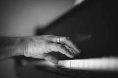 Moment Musical. A man playing the piano . Moment Musical . Music . Musical Perfection in black and white photo. The beauty of music in pictures Royalty Free Stock Photography