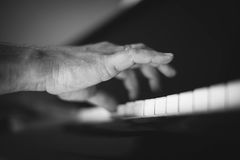 Moment Musical. A man playing the piano . Moment Musical . Music . Musical Perfection in black and white photo. The beauty of music in pictures Royalty Free Stock Photo
