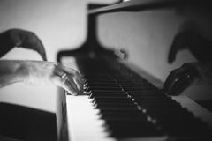 Moment Musical. A man playing the piano . Moment Musical . Music . Musical Perfection in black and white photo. The beauty of music in pictures Royalty Free Stock Image