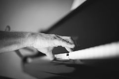 Moment Musical. A man playing the piano . Moment Musical . Music . Musical Perfection in black and white photo. The beauty of music in pictures Stock Photography
