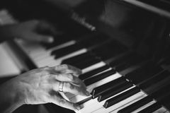 Moment Musical. A man playing the piano . Moment Musical . Music . Musical Perfection in black and white photo. The beauty of music in pictures Stock Photo
