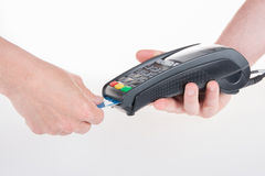 Moment of payment with a credit card insert terminal. Moment of payment with a credit card through terminal Royalty Free Stock Photography
