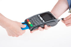 Moment of payment with credit card through terminal. Moment of payment with a credit card through terminal Royalty Free Stock Photo