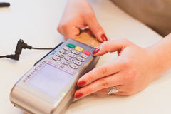 Moment of payment with a credit card through terminal. Moment of payment with a credit card through terminal Royalty Free Stock Images