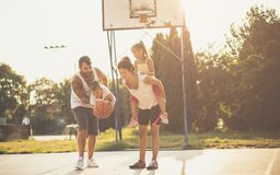 The moment of play and laughter. Family playing basketball royalty free stock photo
