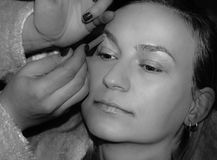 Session Make Up. A moment of the preparing process for a black and white session with ValVal - applying make up royalty free stock photo