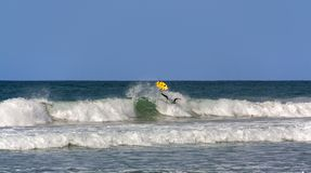The moment the surfer falls off the board stock photos