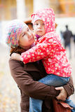 Moment of tenderness. Young mother and her beautiful daughter stock images