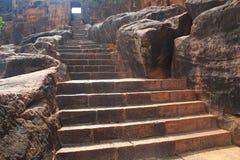 Moment till Badami grottatempel, Karnataka, Indien Arkivfoton