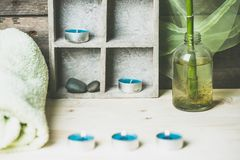 A moment to relax, natural spa and wellness background, raw wood, candles, blue and green colors stock photos