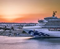 Moments before the departure with the ferry in Rhodes port enjoying the golden hour of sky during sunset royalty free stock photography