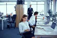 Employees idle in the office stock images