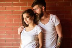 Moments of intimacy. Couple enjoy intimacy cuddling without witnesses. Couple find place to be alone. Couple in love. Hugs brick wall background. Girl and stock image