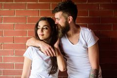 Moments of intimacy. Couple find place to be alone. Couple in love hugs brick wall background. Girl and hipster romantic. Date intimacy moment. Couple enjoy stock photography