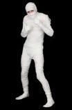 Momia egipcia en un fondo negro imagen de archivo libre de regalías