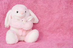 Momma and Bunny. A momma and bunny stuffed animal cuddle together with space to the right for your own text Stock Photography