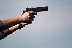 Hand holding Gun Stock Photo