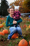 Mommie and Baby in pumpkin patch Stock Photos