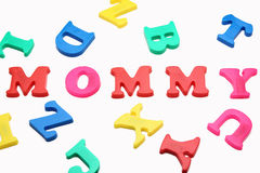 Mommy. Colorful refrigerator magnets spell the word Mommy on a white background Stock Photography