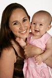 Mommy & Baby. A mother holding her baby girl Stock Image