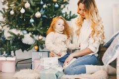 Mommy and daughter wrapping gifts Stock Photography