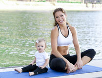 Mommy daughter yoga. Mother daughter Yoga performed on a dock by the lake Royalty Free Stock Photos