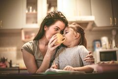 Mommy give try coffee. Close up. Mommy give try coffee.Mother and daughter sharing drink. Close up Stock Photography
