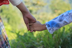 Mommy holds my hand. Mommy and daughter hold their hand ,full of love stock photo