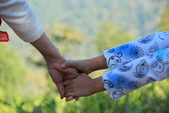 Mommy hold my hand. Mommy and daughter hold their hand ,full of love Stock Photography
