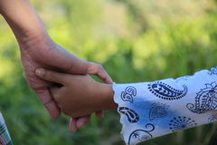 Mommy hold my hand. Mommy and daughter hold their hand ,full of love Royalty Free Stock Images