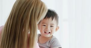 Mommy hug her son. And smile happily at home royalty free stock photo