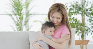 Mommy hug her son. And smile happily at home Royalty Free Stock Photos