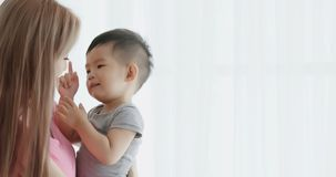 Mommy hug her son. And smile happily at home Stock Photography