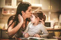 Mommy kiss me for reword. Mother and daughter spending time together Royalty Free Stock Image