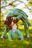 Mommy kissing her cute son. Pretty mommy kissing her cute son. Toned image stock image