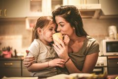Mommy let me try coffee. Little girl. Close up image of mother and daughter Stock Image