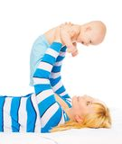 Mommy lifting little baby Stock Photo