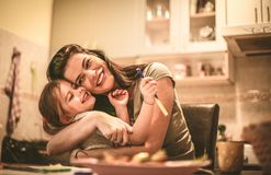 Mommy loves me. Mother and daughter hugging. Happy and smiling mother and daughter Royalty Free Stock Photography