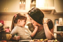 Mommy make me laugh and happy. Close up image of mother and daughter royalty free stock images